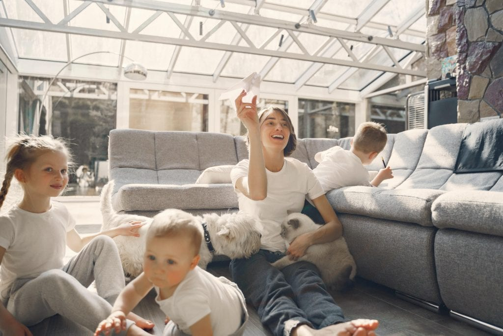 Image of a family relaxing in a conservatory.
