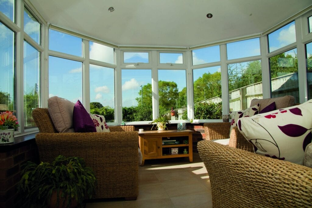 Common Conservatory Problems: Image of the inside of a large conservatory with white windows.