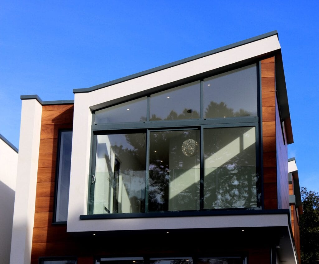 Window Colours: Image of a modern home with a large sloped window.