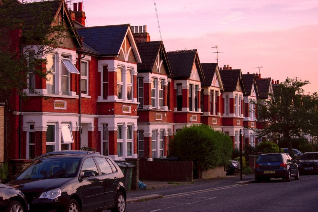 Window Colours: Image of a street of Victorian terraced houses at sunset.