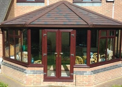 Guardian Warm Roof: Image of a conservatory with a brown Guardian Warm Roof.